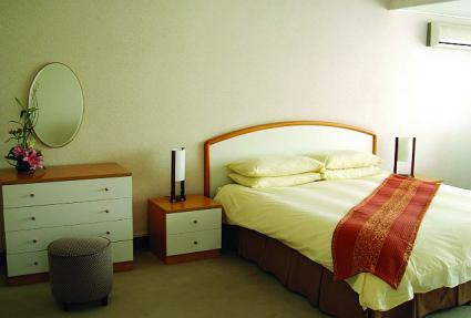 サービスアパートメント ベッドルーム
