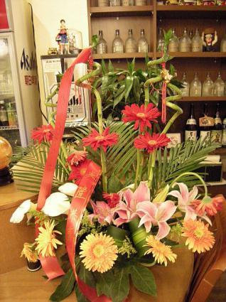 オープンをお祝いする花