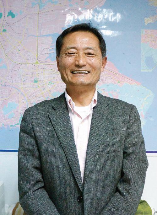 経験を中国の若者に教える伊藤栄俊さん